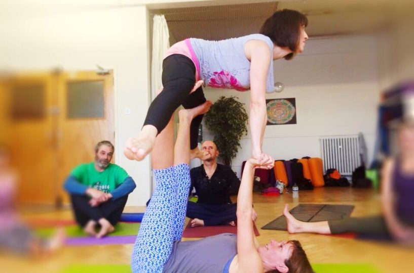 Acro Yoga combines stillness with movement